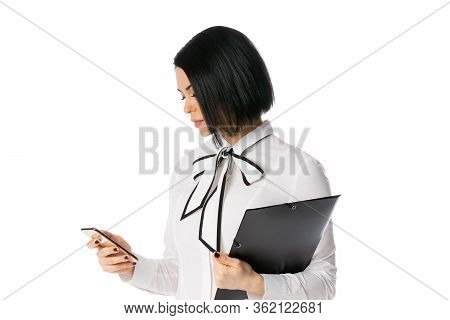 Business Woman Holding A Black Folder With Documents In Hands And Looking On The Phone, Isolated On