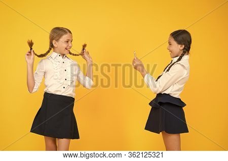 School Girls Use Smartphone To Take Photo. Girls School Uniform. Dont Give Anyone Your Password Addr