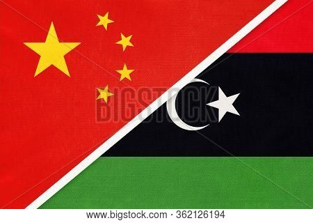 China Or Prc Vs Libya National Flag From Textile. Relationship Between Asian And African Countries.