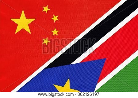 China Or Prc Vs South Sudan National Flag From Textile. Relationship Between Asian And African Count