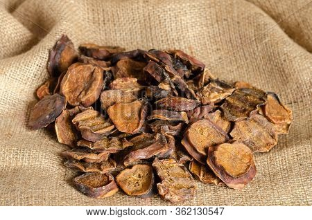 Dried Bull Eggs Close-up. A Pile Of Natural Dried Treats For Dogs On Burlap. Treats For The Promotio