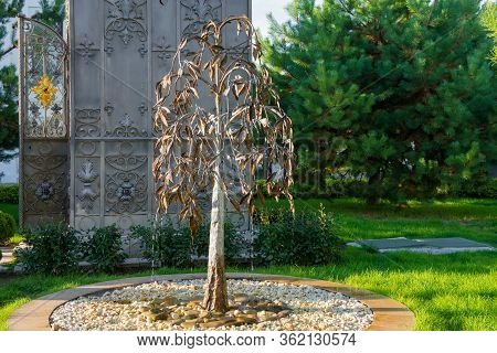 Murom, Russia - August 24, 2019: Weeping Tree Near The Metal