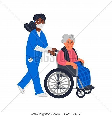 Senior Patient. An Elderly Woman In A Wheelchair And African American Nurse In A Face Mask On A Whit