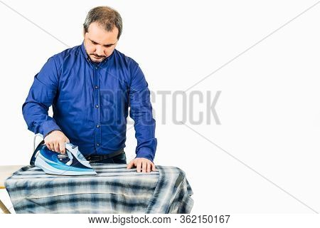 Man Ironing Blue Shirt On A White Background With Copy Space For Text