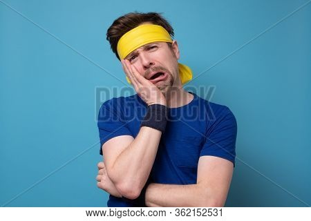 Young Caucasian Sport Man Frowning Face In Displeasure, Keeps Arms Folded.