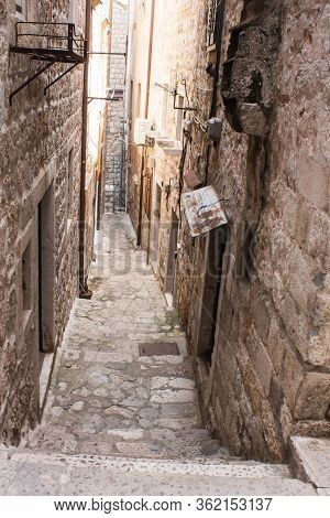 Old City Alley, Streets, And Stairs Of Dubrovnik Old Town, Croatia, Old Stone Walls On Both Side, St