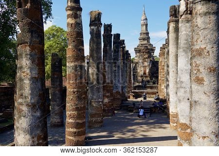 Sukhothai, Thailand - November 11, 2013: People Visit Ruins Of Wat Mahathat In Sukhothai Historical