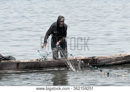 Maumere, Flores Island, Indonesia - January 13 2015: Portrait Of A Fisherman Netting On A Little Boa