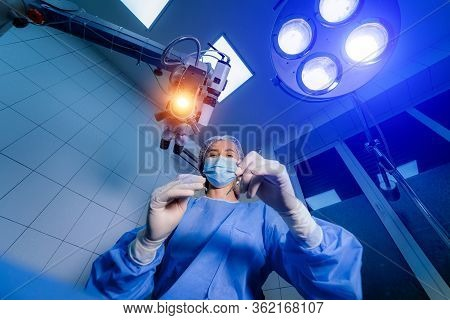 Ophthalmology Laser Microscope Operation. Doctor In Clinic. Patient Eye Treatment. Myopia And Catara