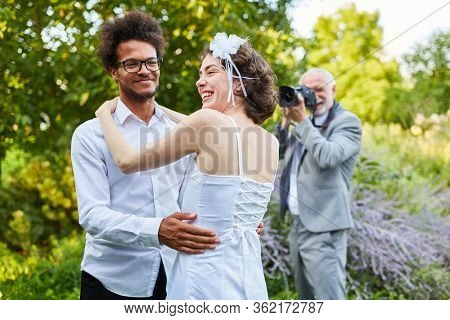 Wedding photographer photographs a happy bride and groom on the wedding day in nature