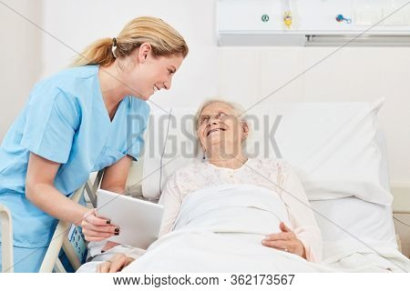 Nursing carer cares for a senior patient in nursing care
