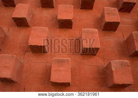 Abstract Orange Bricks With Cubical Structure Popping Out Of The Wall