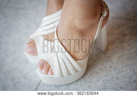 Wedding Bride Shoes. Beautiful Legs - Wedding Concept.