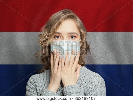 Scared Woman In Medical Mask On Croatian Flag Background. Flu Epidemic And Domestic Violence In Croa