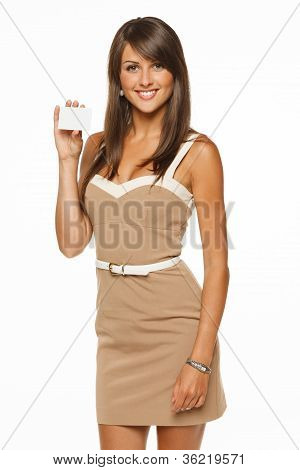 Portrait of young smiling business woman holding credit card isolated on white background poster