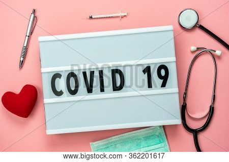 Table Top View Aerial Image Of Accessories Healthcare & Medical With Coronavirus Or Covid-19 Text Ba