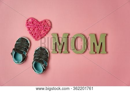 Top View Aerial Image Of Decoration Happy Mothers Day Holiday Background Concept.flat Lay Baby Shoes
