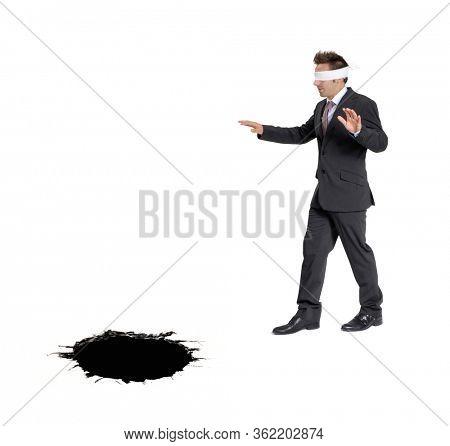 Blind businessman approaching a black hole. Business risk concept.