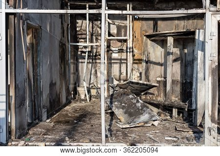 Burnt Room At The Grocery Store. Burned Furniture And Charred Walls In Black Soot. Selective Focus.