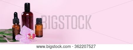 Essential Oils , Various Bottles Aromatherapy On A Pink Background. Aromatherapy And Perfumes Concep