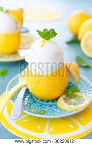 Ice Cold Lemon Sorbet With Fresh Mint Leaves
