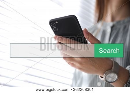 Search Bar Of Internet Browser And Woman Using Smartphone Indoors, Closeup