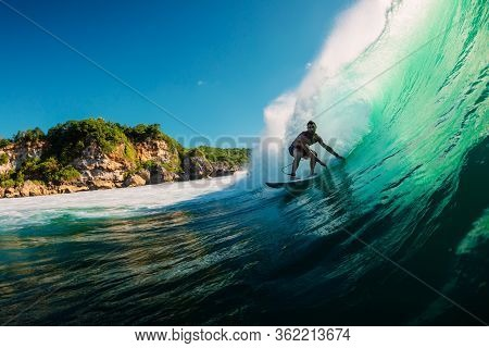 June 2, 2019. Bali, Indonesia. Surfer Ride On Barrel Wave. Professional Surfing At Padang Padang