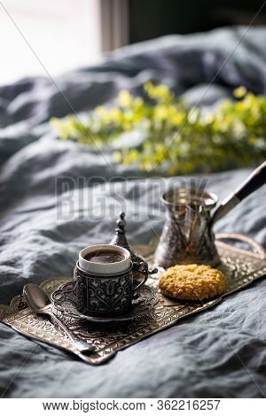 Morning Coffee On Vintage Metal Tray In Bed With Grey Sheet And Pillows.
