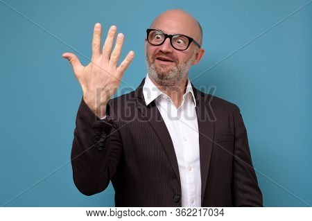 Happy Mature Businessman In Glasses Showing Five Fingers