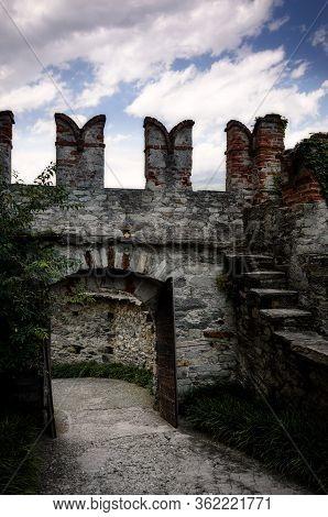 Castle Walls With Battlements, Merlons And Wooden Portals