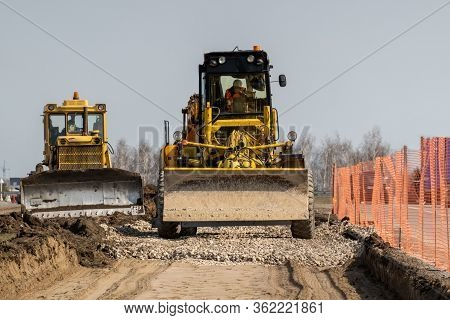 Road Repairs. Expansion Of The Roadbed. Graders Level The Rubble Layer. Selective Focus.