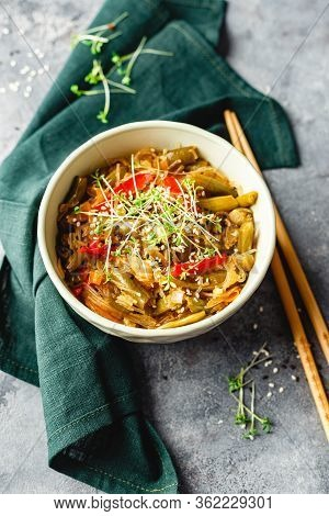 Stir Fry Glass Rice Noodles With Vegetables, Green Beans, Carrot, Bell Peppers, Sesame Seeds And Mic