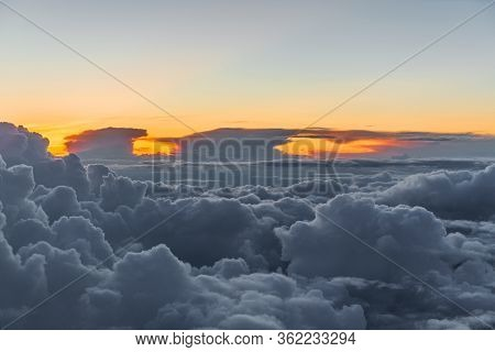 Puffy Clouds At Sunset With This Areial View Above Alaska.