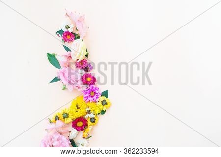 Flowers Composition. Boder Made Of Lilly, Daisy And Eustoma Flowers On Pink Background. Flat Lay, To