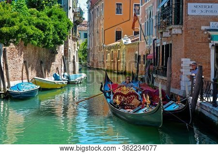 Venice - May 22, 2016 - An Unidentified Gondolier Docks His Gondola In Sestiere San Polo, In Venice,