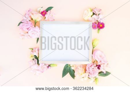 Flowers Composition. Frame With Lilly And Eustoma Flowers On Pink Background. Flat Lay, Top View Sce