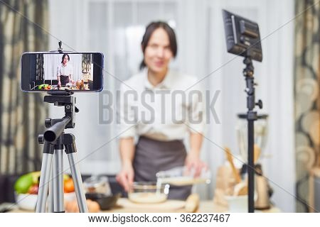 Vlogger Freelance Job, Food Concept. Young Caucasian Woman Cooking And Recording Live Video For Vlog