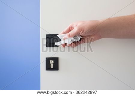 Close Up Of Man Hand Cleaning Door Handle With Disinfectant Wet Pipe, Disinfecting Household Surface