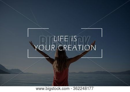Life Is Your Creation Sign Over A Rear View Of A Woman Standing Next To Calm Morning Sea With Her Ar