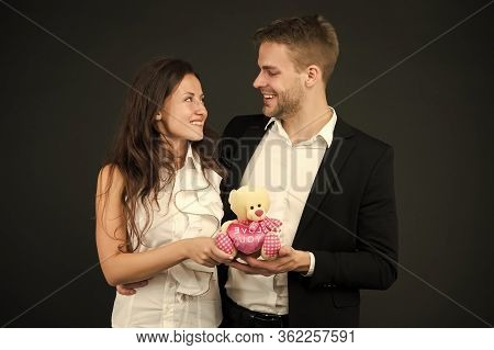 Love Story. Couple On Romantic Date. Formal Couple With Toy Bear. Joint Business. Man And Woman Corp