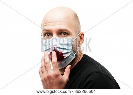 Human population virus, infection, flu disease prevention and industrial exhaust emissions protection concept - bald head man wearing respiratory protective medical mask hand hiding face cough blood