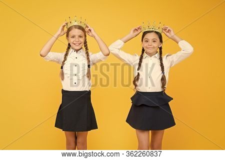 Dreaming About Fame And Richness. Schoolgirls Wear Golden Crowns Symbol Of Respect. Award And Respec