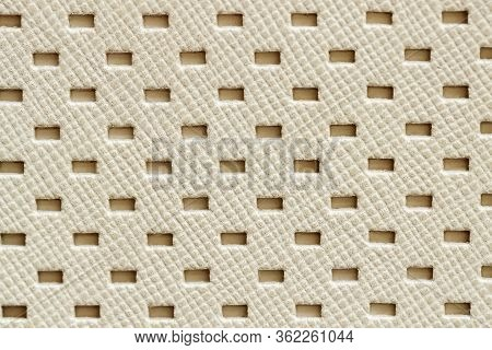 Texture Of Genuine Geometric Perforated Genuine Leather Close-up, Light Cream Paint Color, Backgroun