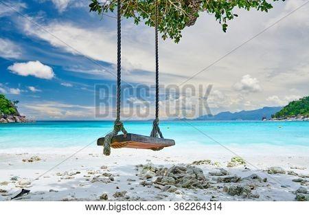 Beautiful Petite Anse beach with swing at Mahe, Seychelles