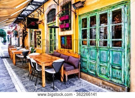 Colorful traditional Greece series - small street restaurants in old town of Rethymno, Crete island