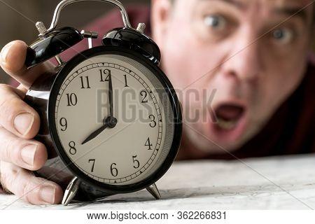 Missing man reaches for an alarm clock
