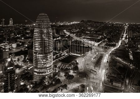 BARCELONA, SPAIN – MAY 13, 2019: Aerial view of city buildings and The Torre Glories in business district at night.