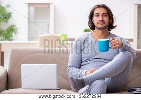 Young male employee freelancer working from home