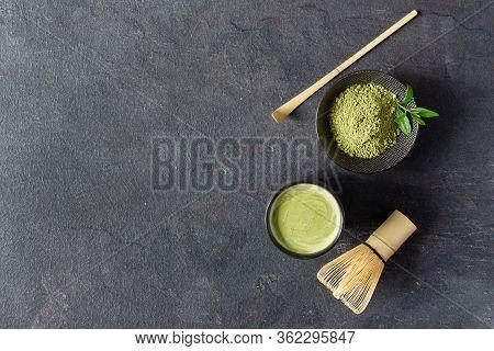 Organic Green Matcha Tea. Matcha Powder And Matcha Tea In A Bowl. Chashaku Spoon And Chasen Bamboo W