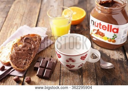 france- april 20 2020- nutella jar, orange juice, milk and bread
